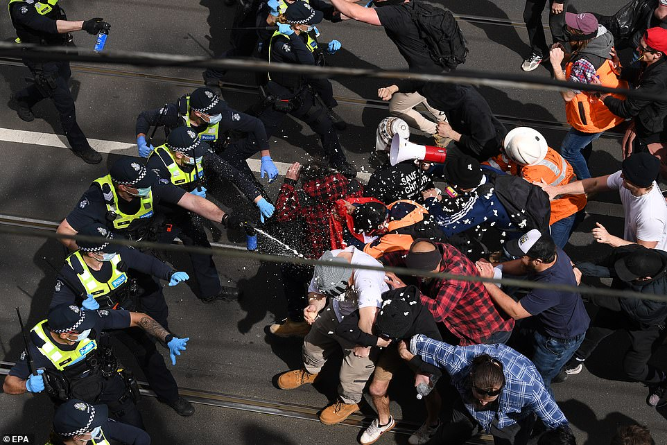 Police were forced to spray to subdue the angry crowd near Melbourne's CBD on Saturday from midday onwards