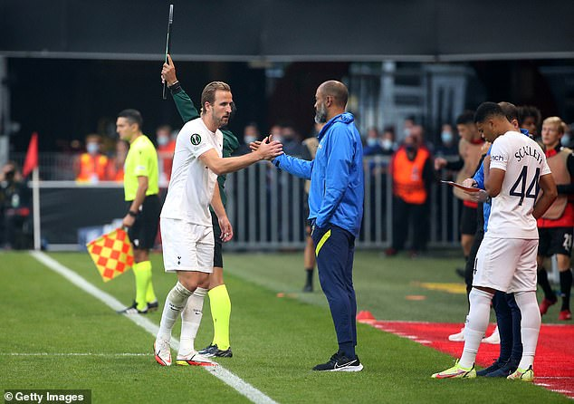 Kane (left) revealed he would remain at Spurs and pledged to focus solely on helping them win