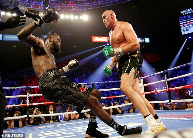 Wilder (left) will be 'broken to pieces', Fury predicts, and is also labeled as a 'bomb'
