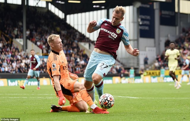 Burnley's Matej Vydra was given a penalty after a challenge from Ramsdale but the decision was overturned by VAR