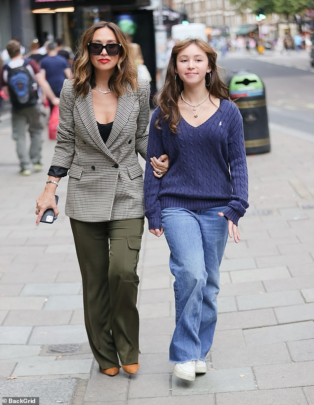 Chic: Myleene Kloss, 43, looked typically chic on Saturday in a fitted check blazer and khaki slacks as she headed to Global Studios, Leicester Square