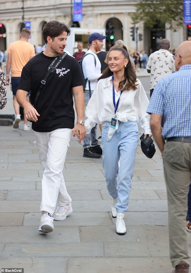 Happy Couple: The star accessorised her monochrome look with gold hoop earrings and a black clutch bag, while Nick opted for a throwback look in white cargo trousers and a black T-shirt.