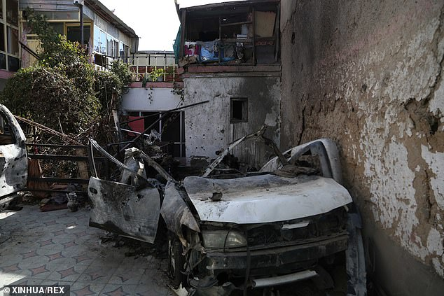 A damaged vehicle at the site of a US airstrike in Kabul that killed 10 civilians, including seven children