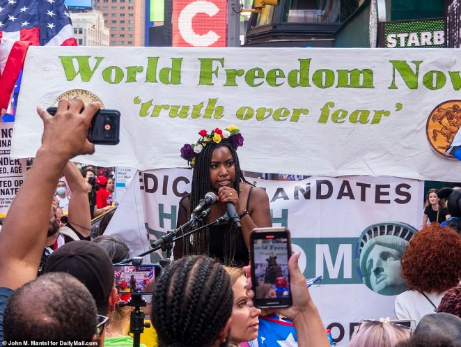 A woman also spoke at the protest and demanded 'truth over fear' while supporters watched and filmed her