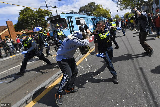 Despite case numbers climbing, up to 1,000 protesters took to the streets of Melbourne on Saturday demanding an end to lockdown (pictured)