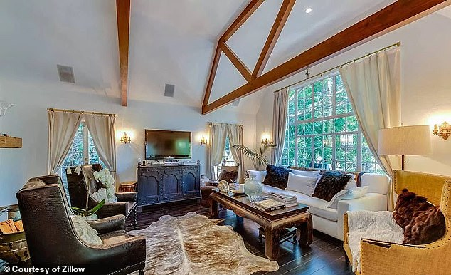 The 7,095-square-foot property has three bedrooms, two bathrooms, a master-bedroom fireplace, and backyard hot tub