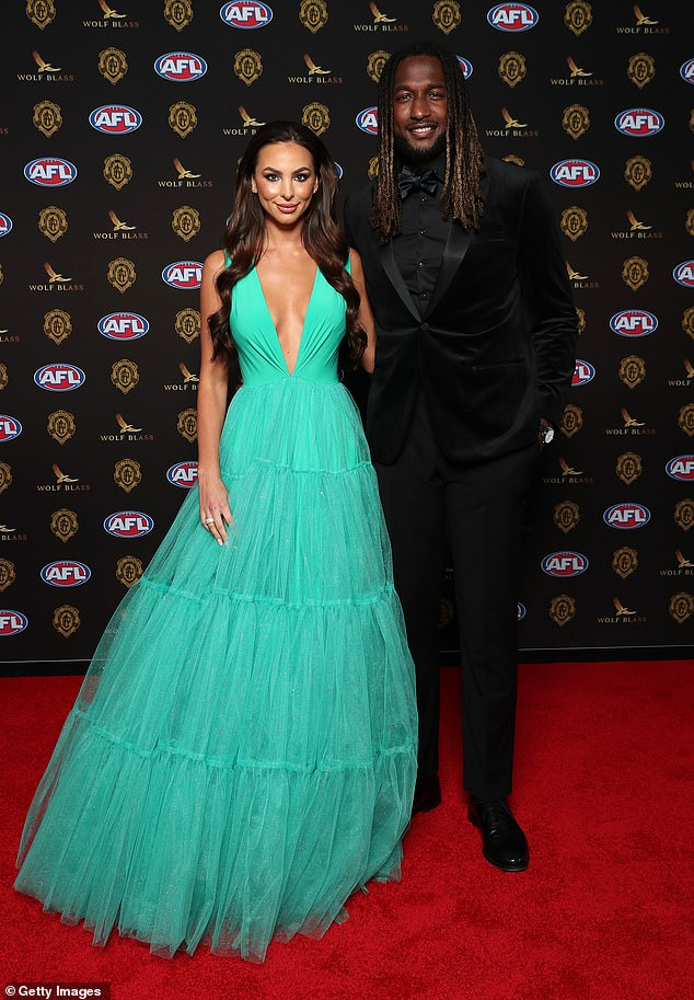 Brilliant: Brittany Bown (left) caught the eye as she arrived at the 2021 Brownlow medal in Perth on Sunday.  The girlfriend of West Coast Eagles player Nic Naitanui (right), 31, arrived at his arm at Optus Stadium, wearing a shiny teal dress