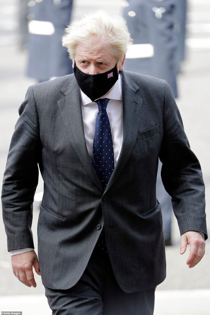 The royals were joined by key government figures including Prime Minister Boris Johnson, who wore a cool gray suit and a black mask.