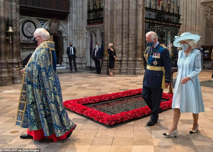 The Dean of Westminster Abbey, David Hoyle, leads the Prince of Wales and the Duchess of Cornwall behind the Tomb of the Unknown Soldier