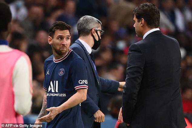 Messi briefly said something to Mauricio Pochettino butdid not stop on his way to the bench