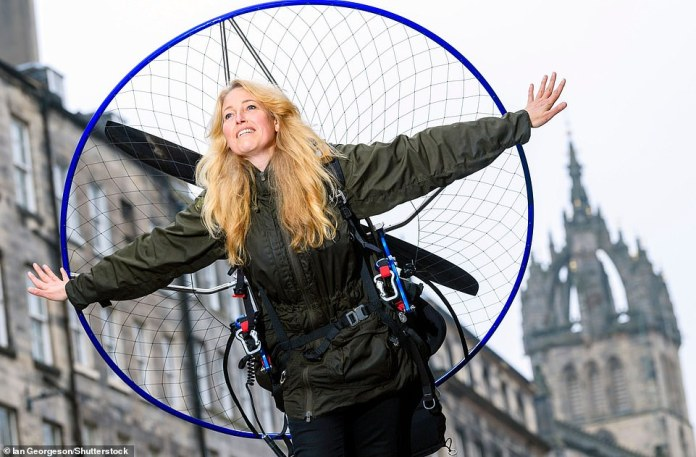 Scientist and paraglider Sacha Dench (pictured) plummeted from the sky on a 3,000-mile journey and record attempt around the UK after colliding with Dan Burton, a member of her support crew who died during the crash in the Scottish Highlands