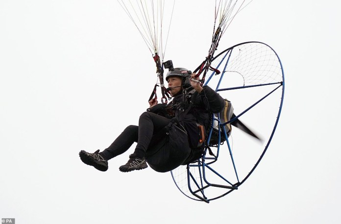 Paramotorist Sacha Dench in flight as she passes the Kelpies near Falkirk as she arrives back into Scotland as part of a world record breaking challenge aimed at raising awareness about the effects of climate change (pictured on September 3)