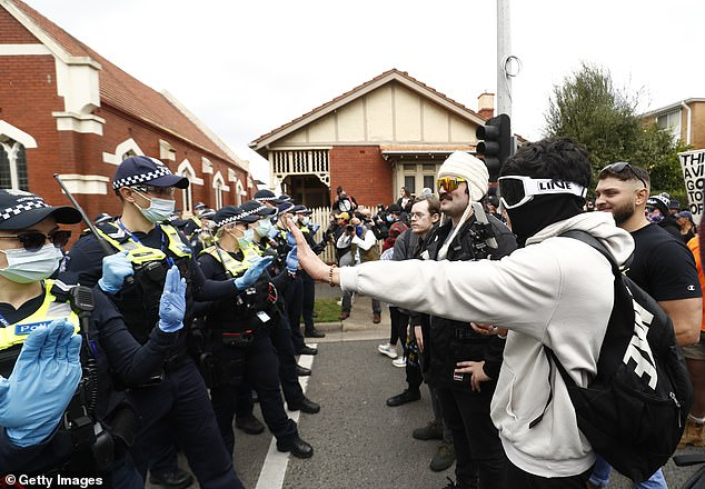 Demonstrators were blocked from marching further by a wall of police along Burnley Street in Richmond