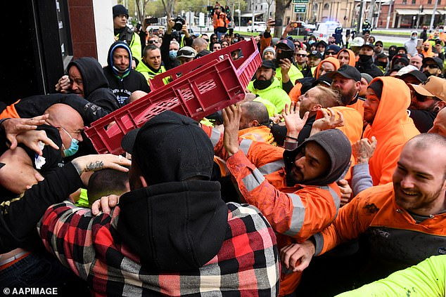 A protest against construction restrictions in Melbourne has turned violent with demonstrators clashing with union officials and hurling a bread crate