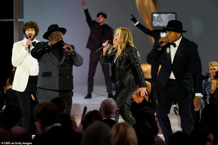Musical number: Cedric the Entertainer, 57, opened the ceremony with a song to the tune of the late rapper Biz Markie's signature song Just A Friend, with assistance from LL Cool J (R) and rapper and actor Lil Dicky (L)