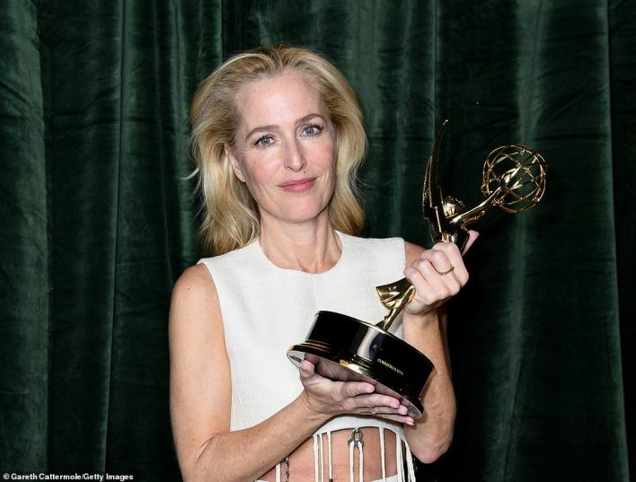 Doubled her record: Anderson celebrated her second Emmy win backstage