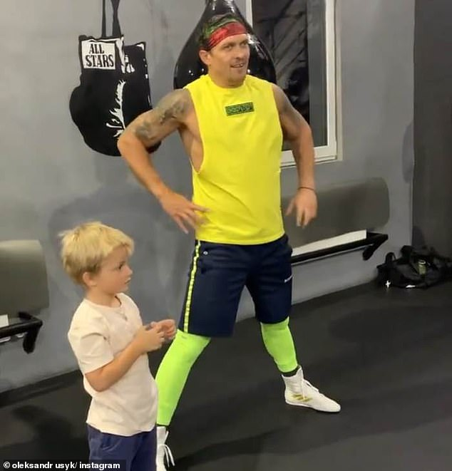 Usyk insisted he's more concerned about his six-year-old son Mykhailo (pictured left) starting school than fighting Joshua