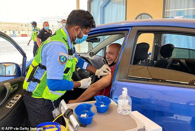 The Gulf Nation has already said that fans should be ready to attend games in the tournament (pictured is a health worker vaccinating a person against COVID-19 in the Qatari city of Al-Waqra)