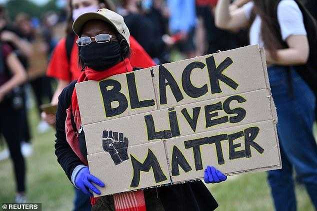 Training on Black Lives Matter (Picture: A Black Lives Matter sign has been held at a protest in London last year) is being offered to NHS England staff as part of a series of new diversity courses.