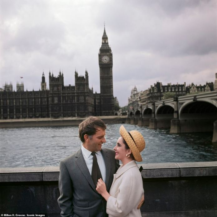 Elizabeth Taylor and Richard Burton in London, 1963 near Westminster on the City's South Bank.  The couple would marry for the first time a year later - and then remarried in 1975 after divorcing in 1974.