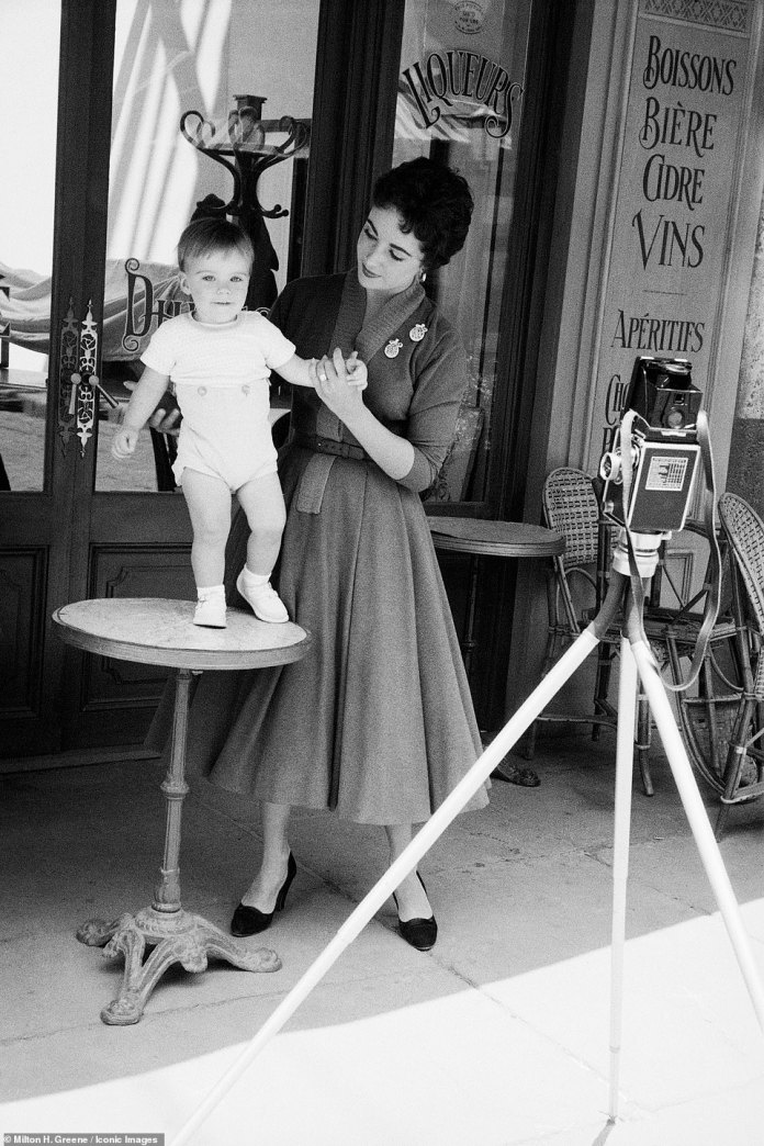 The star wore an A-line dress and black heels for the shoot, which hasn't been widely shared since she was photographed nearly 70 years ago.