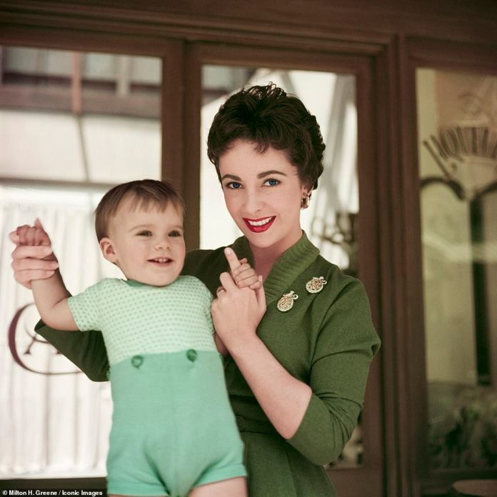 Doting Mom: Elizabeth Taylor with her 16-month-old son, Michael Wilding Jr. in May 1954 - they had four children in their lifetime
