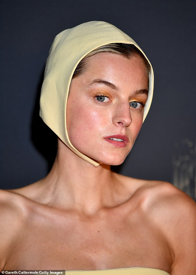Completing her outfit with long fingerless gloves, Emma (pictured) parted her hair away from her face so the headpiece could sit comfortably while opting for a glamorous makeup look.