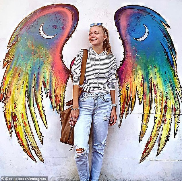 Joseph, the father of missing Van-Life girl Gabby Petito, shared a tribute to his daughter on social media on Sunday with a photo adorned with angel wings (pictured) and the caption: 'She touched the world'