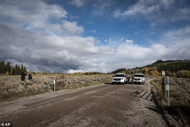 U.S. Park Rangers block access in front of the Spread Creek area of the Bridger-Teton National Forest