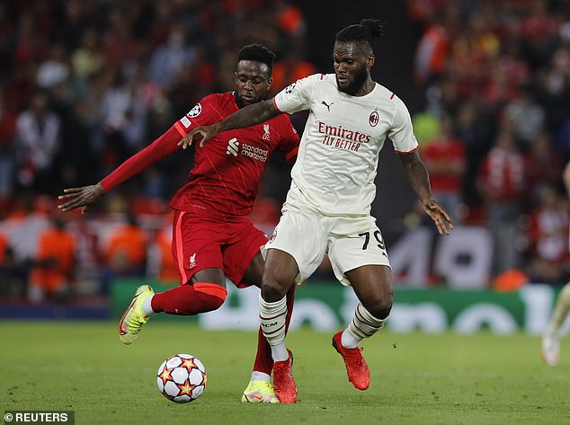 Kessie battles for the ball with Divock Origi in AC Milan's 3-2 defeat to Liverpool on Wednesday