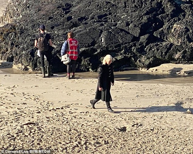 Production: Matt, joined by several crew members as they filmed a scene on the beach