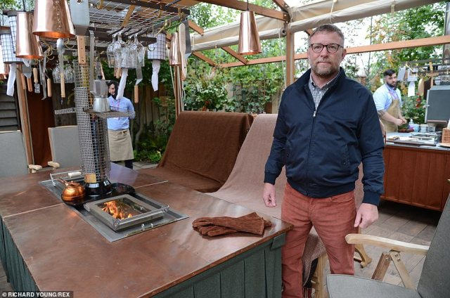Guy Ritchie, 53, was joined by his wife Jacqui Ainsley as they unveiled his £50,000 luxury BBQ on the first day of the Chelsea Flower Show