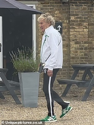 Casual: Sporting his trademark blond locks, Rod wore a pair of green trainers on his feet