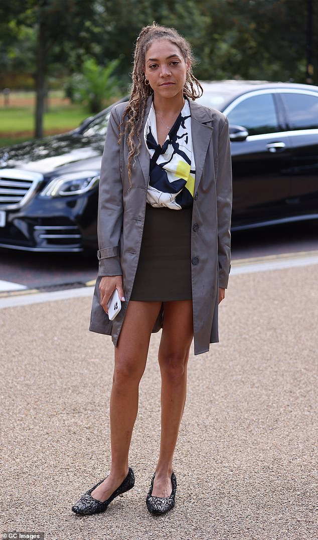 Style: The former T4 host also wore a gray jacket while she added a shimmery detail to her outfit with a pair of black flats