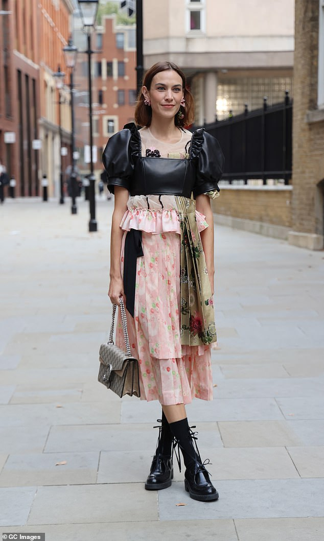, Alexa Chung commands attention in a puff-sleeve black and pink smock dress, The Evepost BBC News