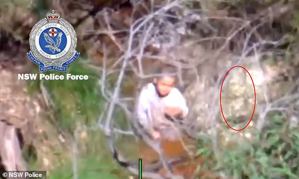 A blurry image taken from a police helicopter has given Anthony 'AJ' Elfalak's family all the proof they need that he was being cared for by an angel while lost in the bush