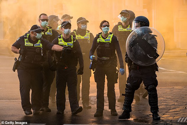 A heavy police presence is seen on Elizabeth Street during a protest at the CFMEU headquarters on Monday