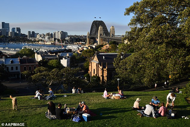 Local residents can use the website to catch up with nearby family and friends - and follow Covid rules at the same time (pictured, Sydney residents at Observatory Hill)