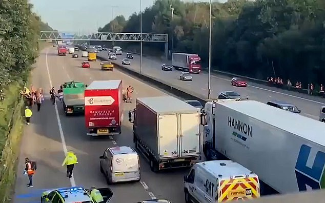 Members of the eco-group Insulate Britain are blocking traffic on the motorway near junction 10 in Surrey
