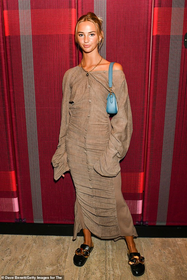 , Romeo Beckham's girlfriend Mia Regan looks chic in a slouchy beige dress at the Dazed event at LFW, The Evepost BBC News
