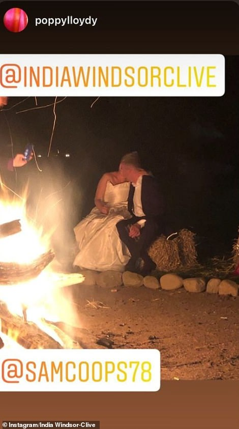 Displaying their love status, the couple was also pictured enjoying a kiss together while sitting near a bonfire (pictured)