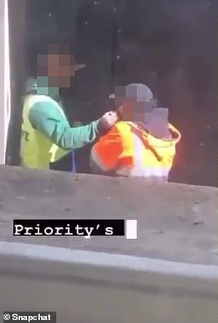 Pictured: One of the tradies snorts the mysterious white powder