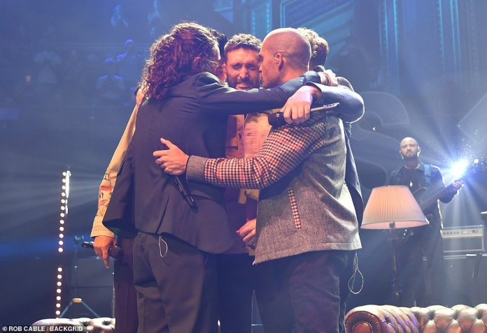 Man of the Hour: Tom gets emotional on stage as his bandmates wrap him in a group hug during the show and Max gives him a kiss on the cheek