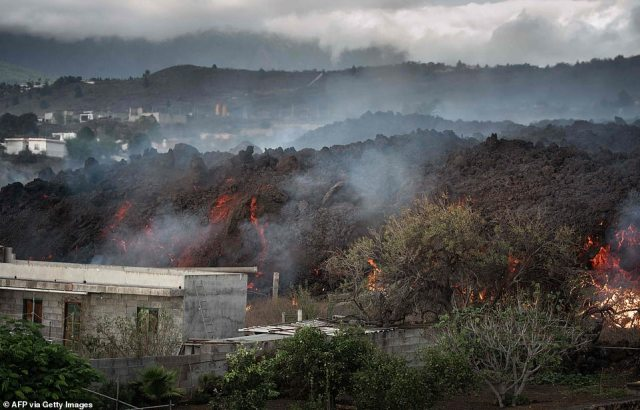 The volcanic eruption sent vast plumes of black smoke into the air and molten lava oozing down the mountainside
