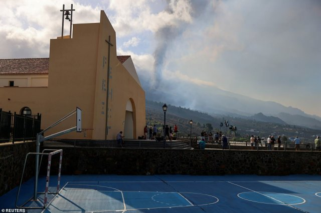 Smoke rises near a church in Los Llanos de Aridane on La Palma on Tuesday