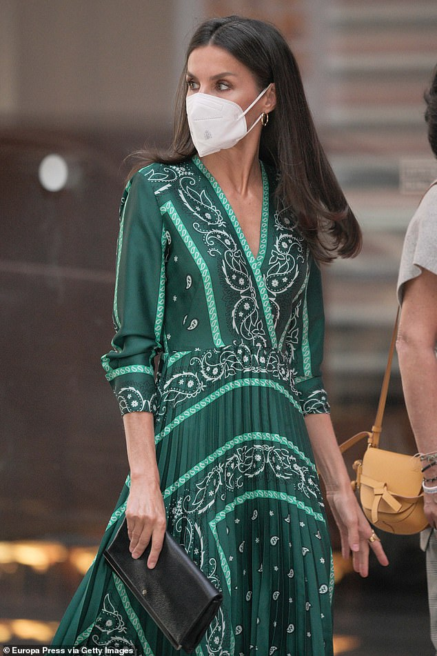 Queen Letizia of Spain, 48, recycled a silk scarf dress with a pleated skirt by Sandro to attended the 11th Santander Social Porject awards in Madrid today, pictured