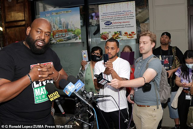 Hawk Newsome (left), a co-founder of BLM's New York chapter, speaks during the protest