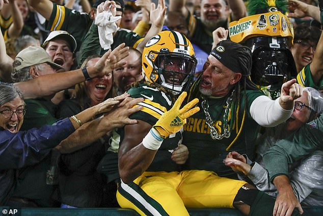 Green Bay Packers' Aaron Jones celebrates his touchdown run during the second half Monday