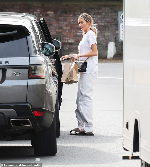 Big labels: Despite her relaxed attire, she donned luxury designer accessories including a black quilted Chanel bag and Louis Vuitton sliders