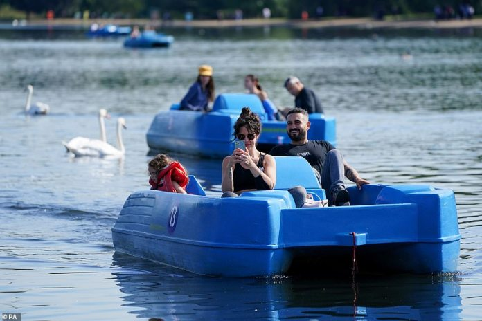 People have been enjoying the pedalos on the Serpentine at London's Hyde Park where temperatures have peaked at 73F. The weather is expected to stay warm until the weekend